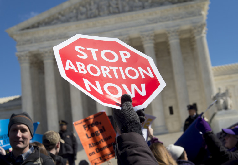 Image: Anti-abortion activists outside the Supreme Court in Washington, D.C., on March 2