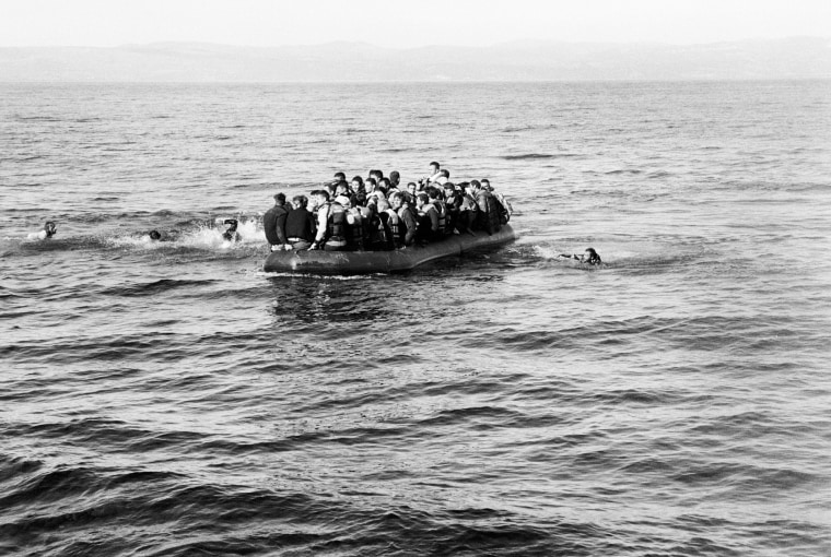 Photographer Giles Duley believes there is a chance to make a difference with even one picture. The London native was working in Sangsar, Afghanistan when he stepped on a landmine. He has endured more than 30 operations in the five years since.   Above: An overcrowded boat of refugees heads to the shore. Two men had fallen from the boat; they were rescued by volunteer Spanish Lifeguards in Lesvos on Oct. 28.