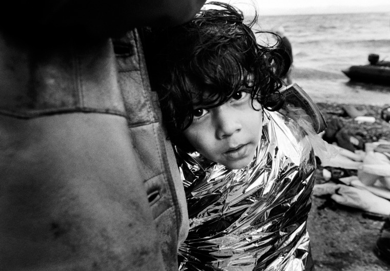 A young boy tries to keep warm after a cold and wet crossing from Turkey. Cases of hypothermia are on the increase as the weather deteriorates across the eastern Mediterranean in Lesvos on Oct. 28.