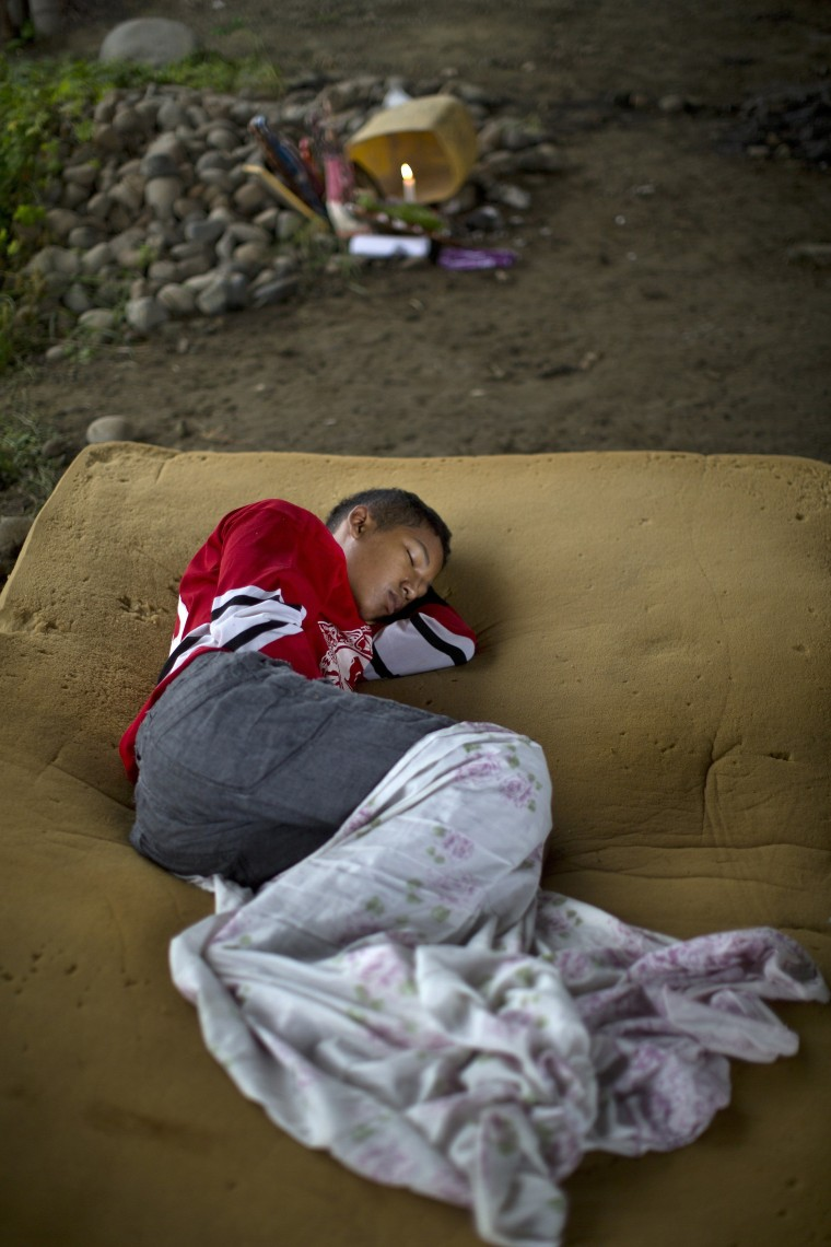 Image: A youth sleeps on a foam mattress after loosing his home in the earthquake in Pedernales, Ecuador