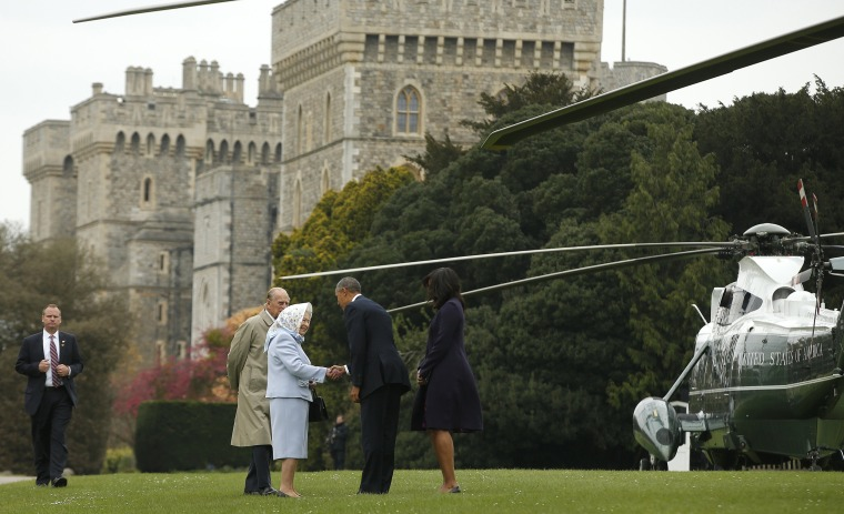 Image: The Obamas are greeted by Britain's Queen Elizabeth II and Prince Phillip after landing at Windsor Castle