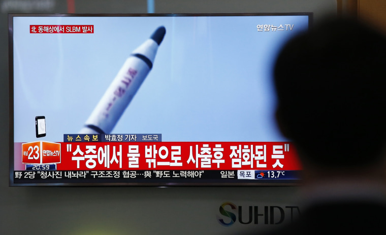 Image: A man in South Korea watches a TV news program showing a missile launch conducted by North Korea, Saturday.