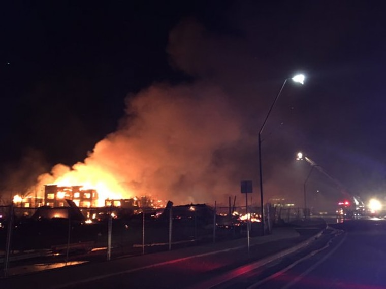 This photo posted to Twitter by Gilbert Fire Rescue shows flames after an apartment complex went up in flames Saturday.