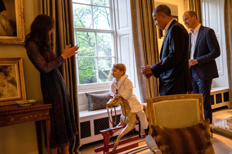 Image of Prince George on rocking horse in front of President Obama