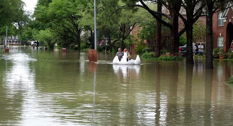 Midwife rides inflatable swan through Houston floods to deliver baby