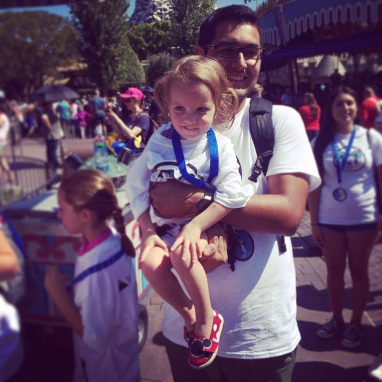 Anderson's daughter, Jazmine, in Disneyland with Danny from Together We Rise