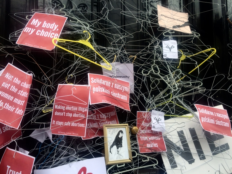 Coat hangers are placed at the door of the Polish Embassy in London.