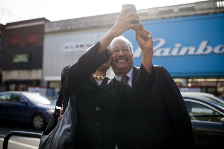 Rep. Chaka Fattah, D-Pa., poses for a selfie while he campaigns in west Philadelphia with other local Democrats on Tuesday, April 19, 2016, in advance of the Pennsylvania primary.