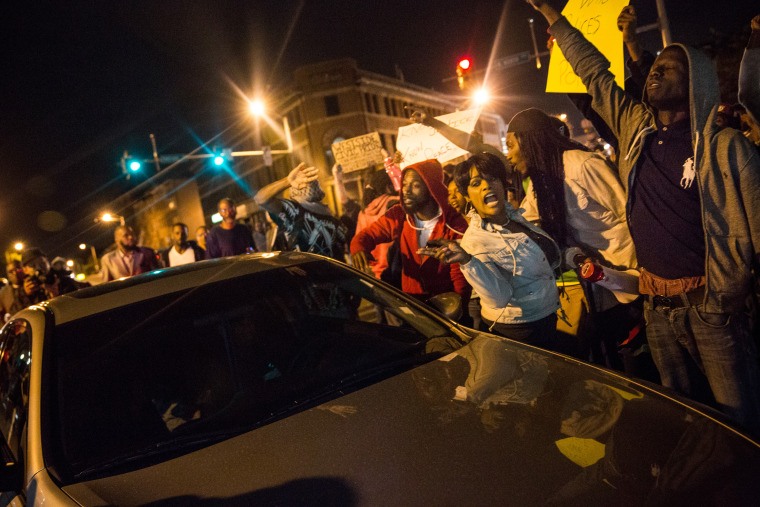 People protesting the death of Freddie Gray and demanding police accountability move into the streets in the Sandtown neighborhood where Gray was arrested on April 30, 2015 in Baltimore, Maryland.