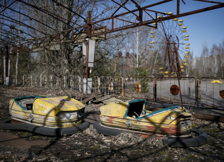 Image: A view of an amusement park in the centre of the abandoned town of Pripyat near the Chernobyl nuclear power plant