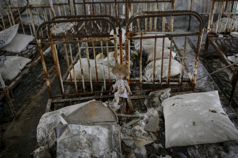 Image: A doll is seen amongst beds at a kindergarten in the abandoned city of Pripyat near the Chernobyl nuclear power plant