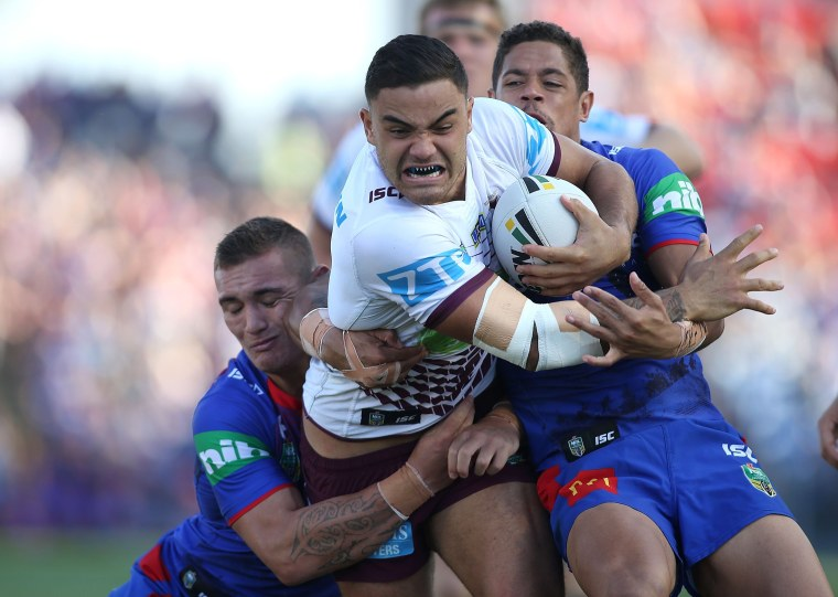 Dylan Walker of the Manly Sea Eagles is tackled by the Knights defence during the round eight NRL match between the Newcastle Knights and the Manly Sea Eagles at Hunter Stadium in Newcastle, Australia on April 25, 2016.