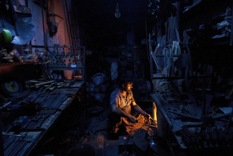 Image: a Pakistani black smith at work