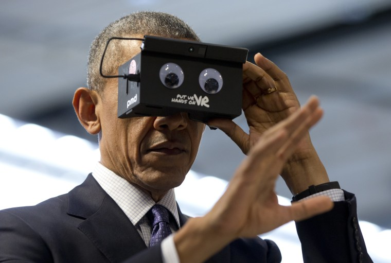 President Barack Obama looks at his hand as he tests VR goggles when touring the Hannover Messe, the world's largest industrial technology trade fair, in Hannover, northern Germany, on April 25, 2016. Obama is on a two-day official visit to Germany.