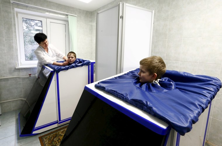 Image: Children, who permanently live at the territory contaminated with radionuclides after the Chernobyl nuclear power plant accident, take physiotherapy while they are in a children's rehabilitation and health centre on the outskirts of Minsk