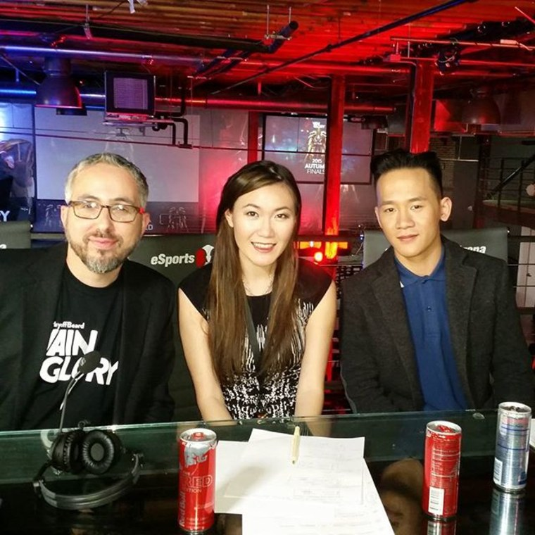 "Rumay ""Hafu"" Wang, at center and a 25-year-old professional gamer, commentating at a video game tournament."