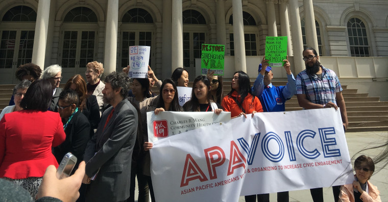 Members of APA VOICE, a coalition of non-profits focused on Asian American and Pacific Islander engagement, speaking on the steps of the New York City city hall.