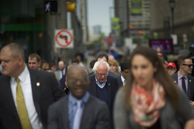 Image: Sen. Bernie Sanders of Vermont, a Democratic presidential hopeful, walks through Center City in Philadelphia.