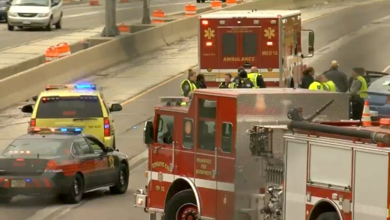 Image: woman driving on Milwaukee freeway shot