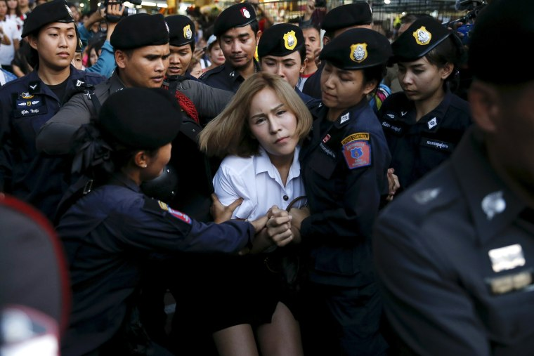 Image: A student activist is detained during a silent protest in Bangkok