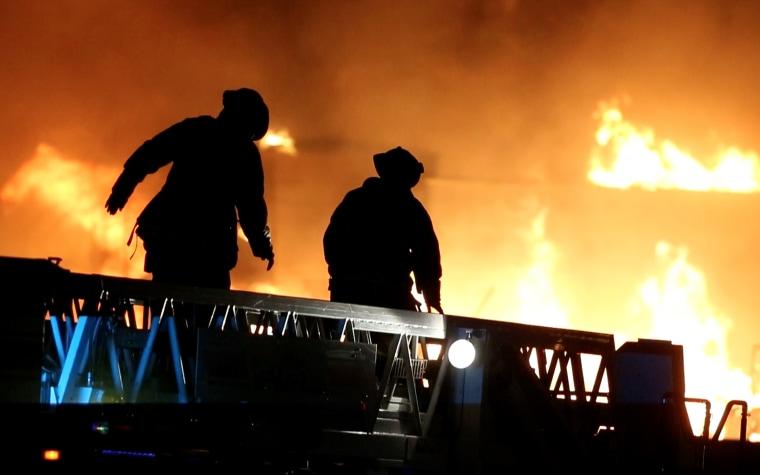 Fire crews battle a blaze in the Phoenix suburb of Gilbert, Ariz., Saturday, April 23, 2016.