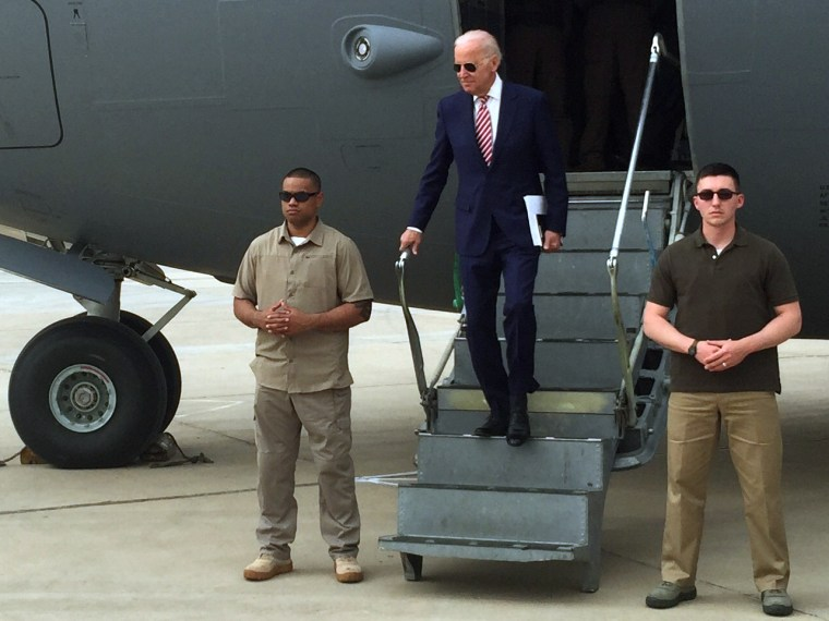 Vice President Joe Biden steps off a C-17 military transport plane upon his arrival in Baghdad, Iraq, on April 28.