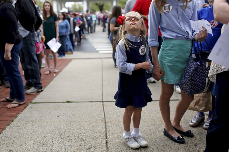 Image: Ella Langdon, 6, waits in line before a campaign rally for Republican U.S. presidential candidate Donald Trump at The Klein Memorial Auditorium in Bridgeport, Connecticut, U.S.