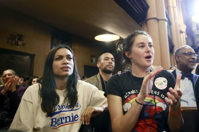 Image: Actresses Rosario Dawson (L) and Shailene Woodley (R) listen to U.S. Democratic presidential candidate Bernie Sanders speak during a discussion at the First Unitarian Congregational Society in the Brooklyn borough of New York