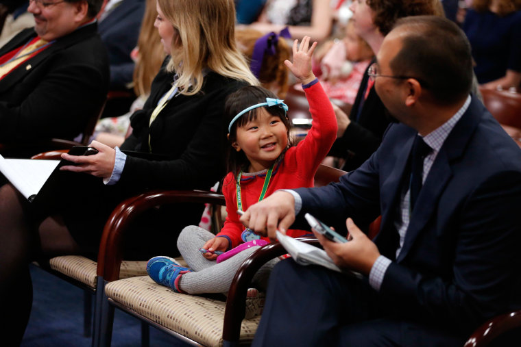 Image: Wong mimics her father  during Ryan's weekly news conference on Take Our Daughters and Sons to Work Day at the U.S. Capitol in Washington