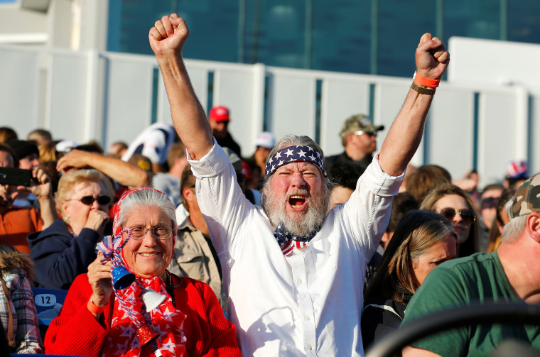 Image: Supporters of Republican U.S. presidential candidate Donald Trump cheer at a campaign rally in Costa Mesa, California