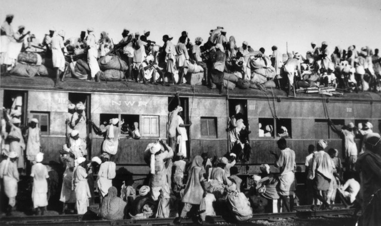 Muslim refugees sit on the roof of an overcrowded train near New Delhi as they try to flee India on Sept. 19, 1947. In the partition of the subcontinent into India and Pakistan after gaining independence from Britain in 1947, an estimated 1 million Hindus, Muslims and Sikhs were killed in rioting, and 12 million were uprooted from their homes.