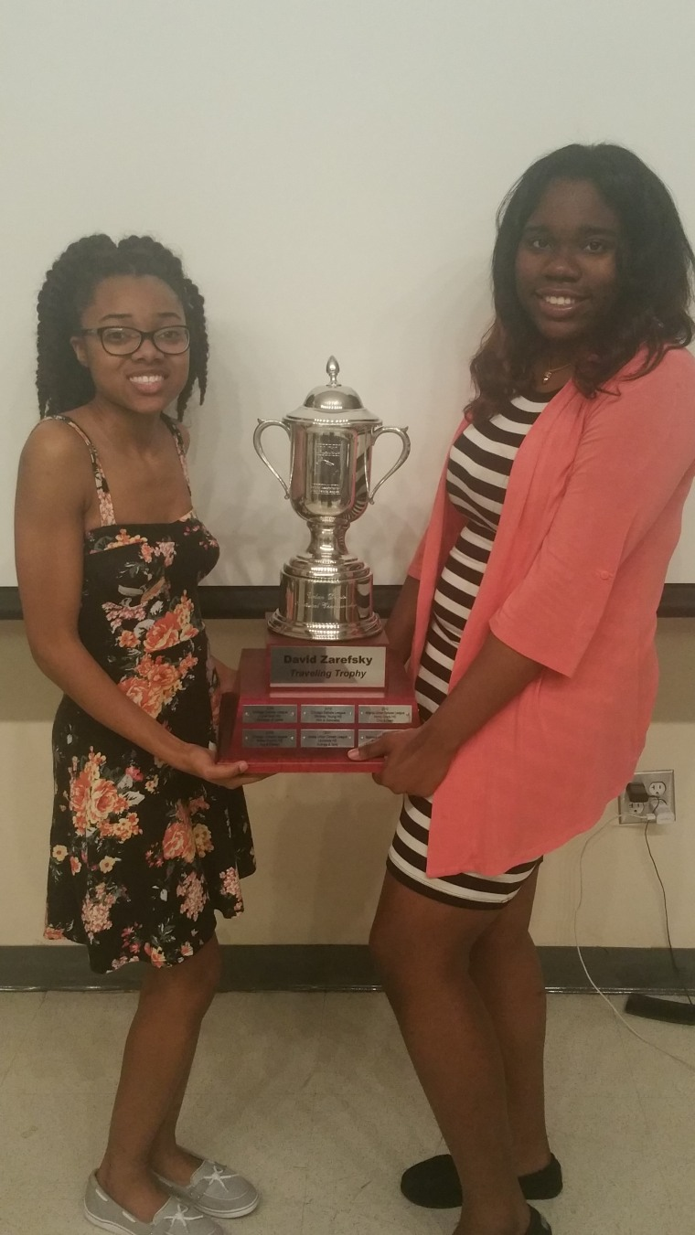 Tamara Morrison (left) and Tiera Colvin (right) hold their trophy after winning the Urban Debate League's National Championship in San Francisco.