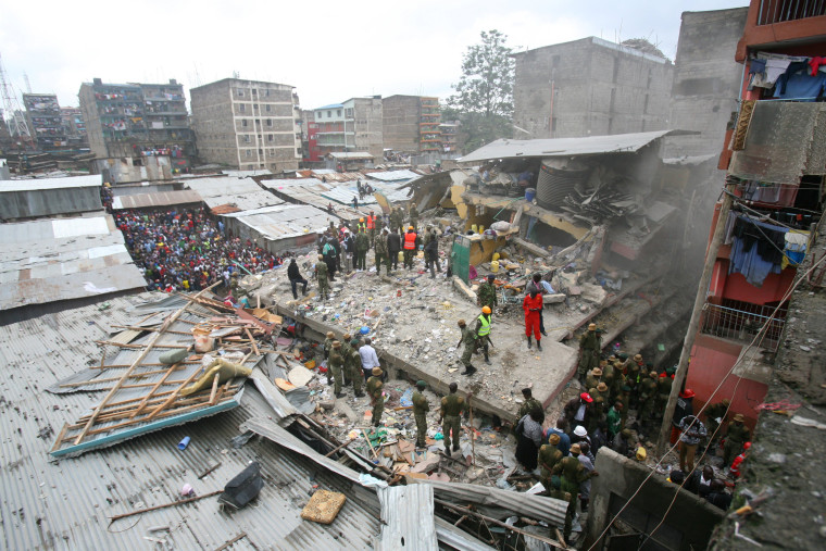 Image: A general view shows rescue workers searching for residents feared trapped in the rubble of a six-storey building that collapsed after days of heavy rain, in Nairobi, Kenya