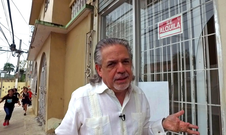 Luis Miranda in front of the travel agency in Vega Alta, Puerto Rico that his mother ran. The town, like the rest of the island, is in a deepening and serious fiscal crisis.