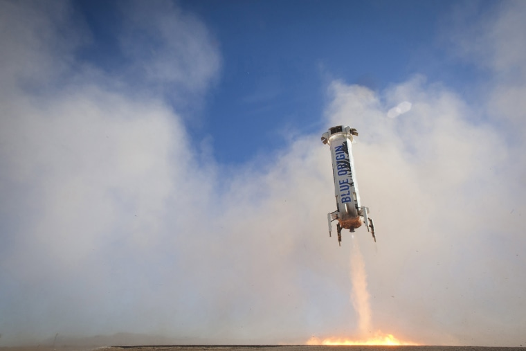 Image: Handout photo The New Shepard rocket booster lands in West Texas