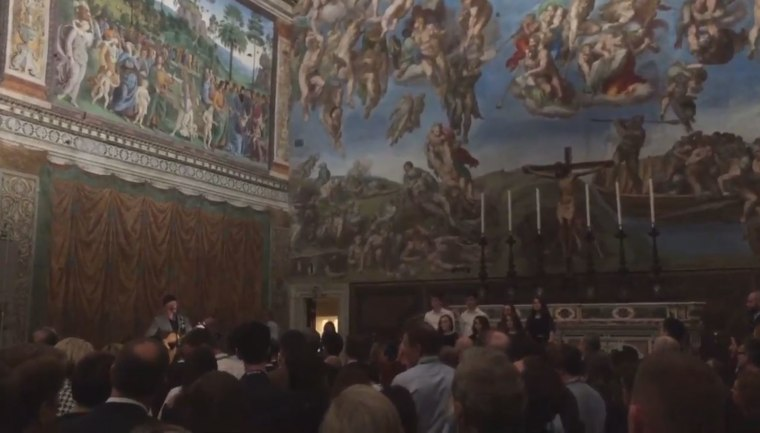 Image: U2's The Edge plays a set inside the Sistine Chapel.