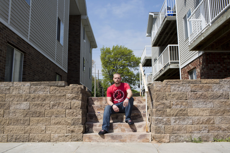 Image: Leo Guthmiller poses for a portrait outside his apartment in Lincoln