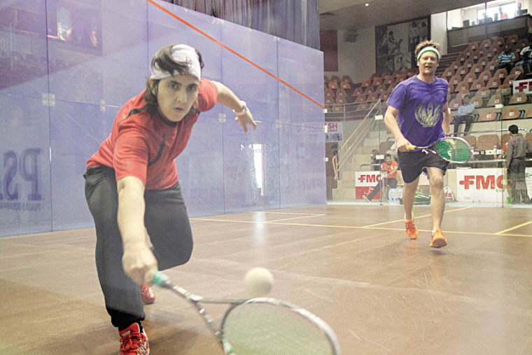 Toorpakai and her coach, Jonathon Power, getting a feel for the court the 2014 Asian Squash Championship in Pakistan.