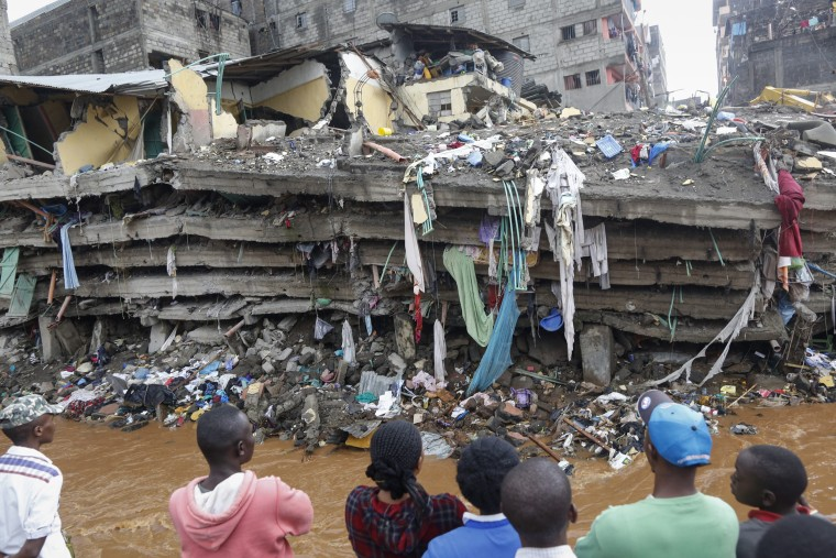 Image: Residents look at the collapsed building in Nairobi on Sunday