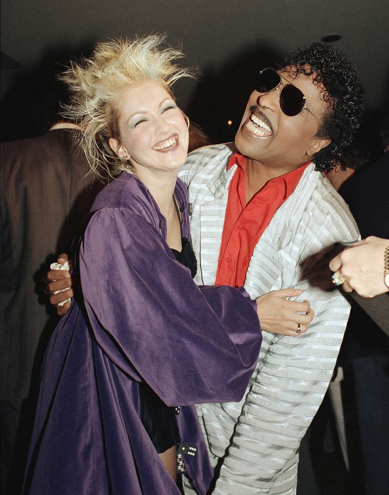 Singers Cyndi Lauper of 1980s and Little Richard of the 1950s find a common note to share during ceremonies honoring American Bandstand and its host, Dick Clark, at Chassens Restaurant, Sept. 15, 1987, Los Angeles, Calif.