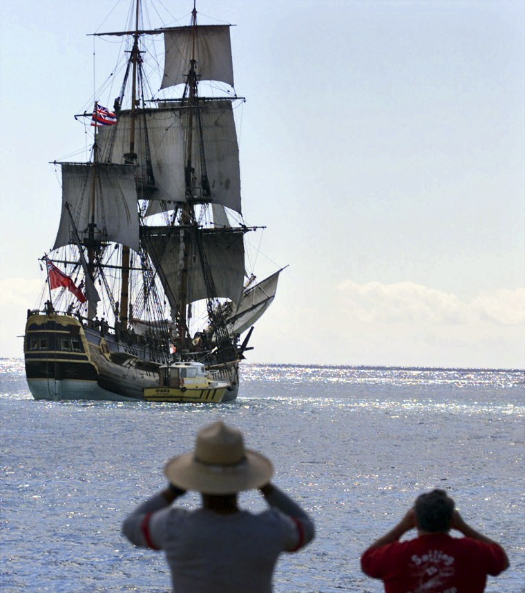 People watch as a replica of the HMB Endeavour leaves Honolulu, Hawaii as it embarked on a four-year, around the world cruise on Nov.15,1999 .