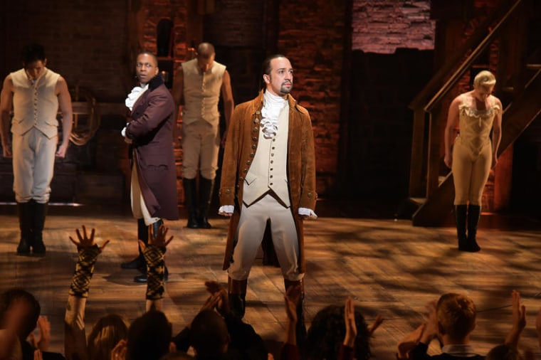 "Actor Leslie Odom, Jr. (L)  and actor, composer Lin-Manuel Miranda (R) and cast of ""Hamilton"" perform on stage."