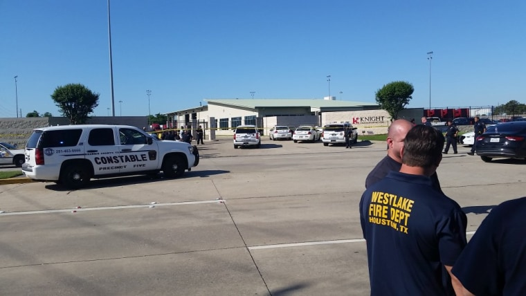 Police respond at the scene of shootings at Knight Transportation in Katy, Texas.