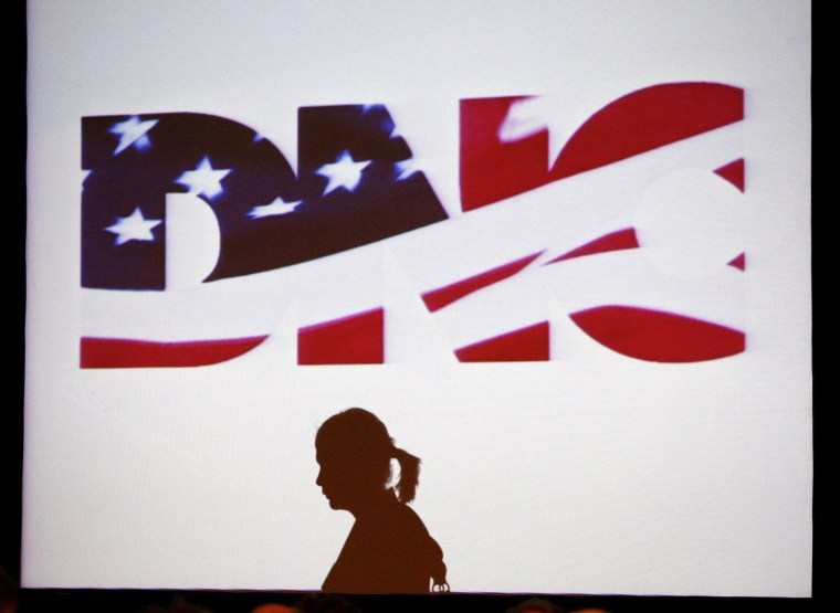 Image: File photo of a woman silhouetted during the DNC Rules and Bylaws Committee meeting in Washington