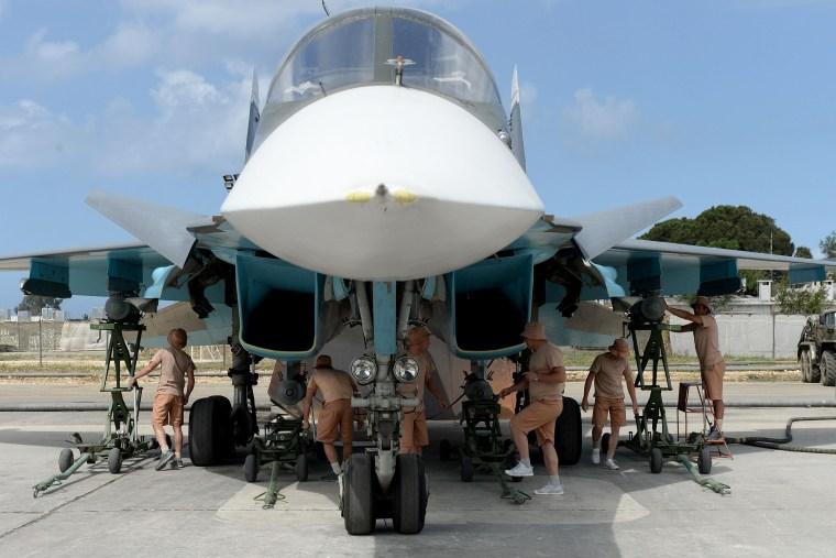 Image: Russian servicemen prepare an SU-34 fighter