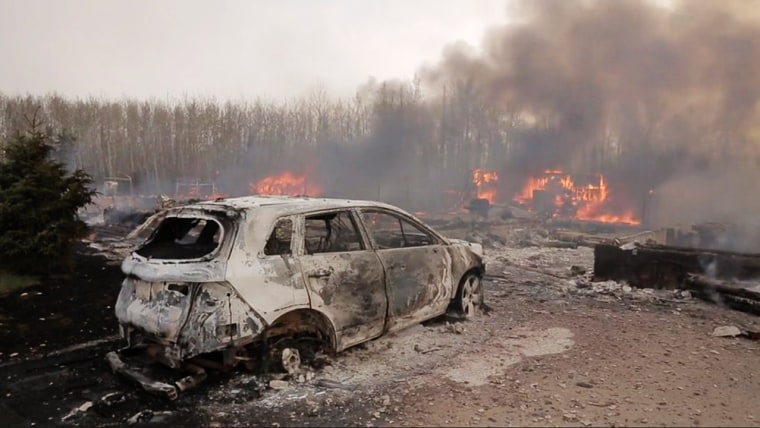 A massive wildfire engulfs Fort McMurray on May 5 after 88,000 people evacuated the area.