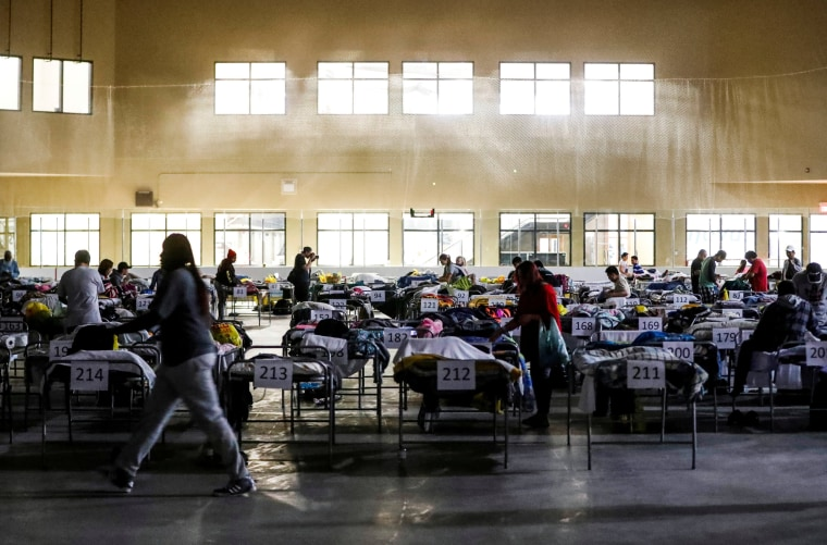 """Image: Evacuees from the Fort McMurray wildfires use the sleeping room at the """"Bold Center"""" in Lac la Biche"""