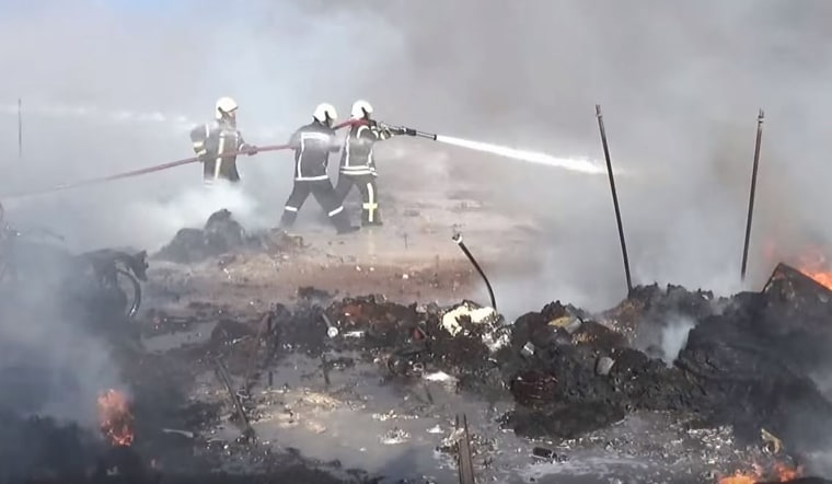 Firefighters battle blazes after an airstrike on a refugee camp near Sarmada, in Syria's northwestern Idlib province on May 5. It is unclear who conducted the airstrike.