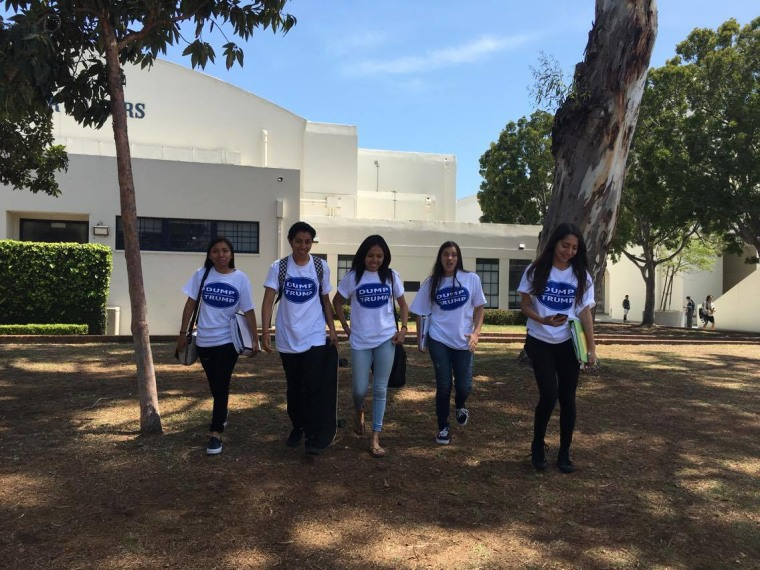 Latino students from Newport Harbor High School in California walk through campus wearing their anti-Donald Trump T-shirts.