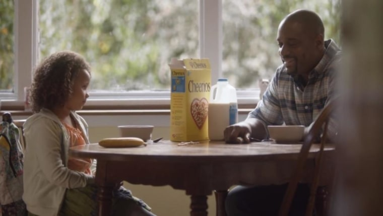 A snapshot of a Cheerios ad featuring a biracial family.